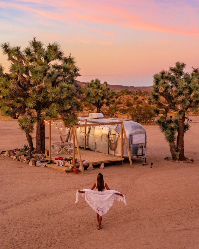 sunset behind vintage airstream in joshua tree