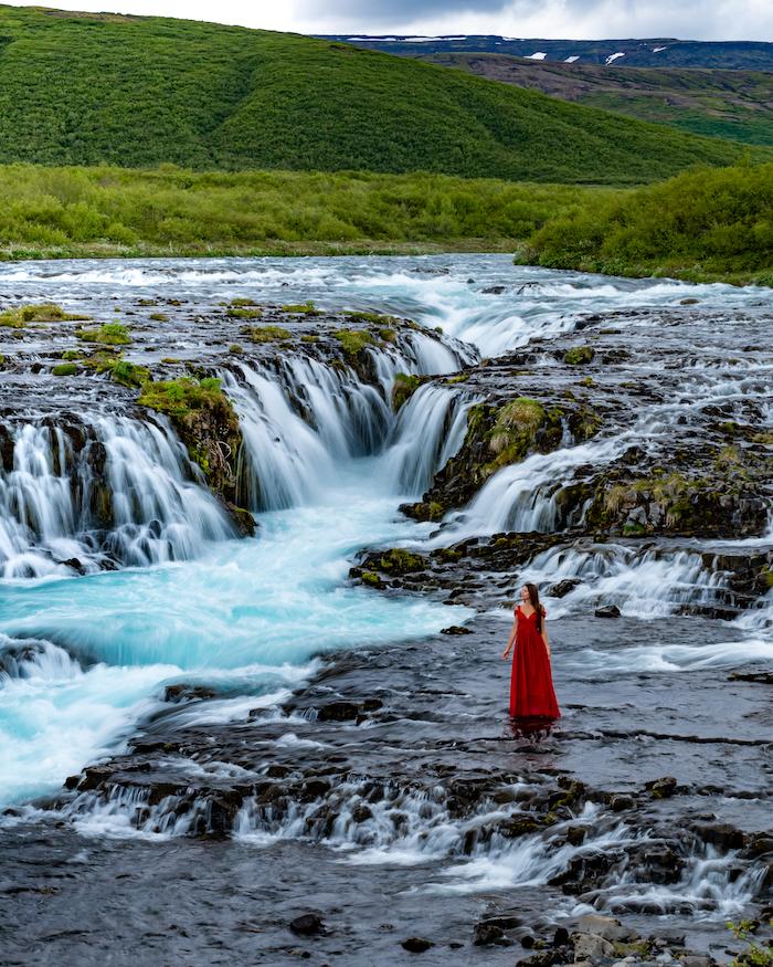 Island Highlights Bruarfoss waterfall red dress