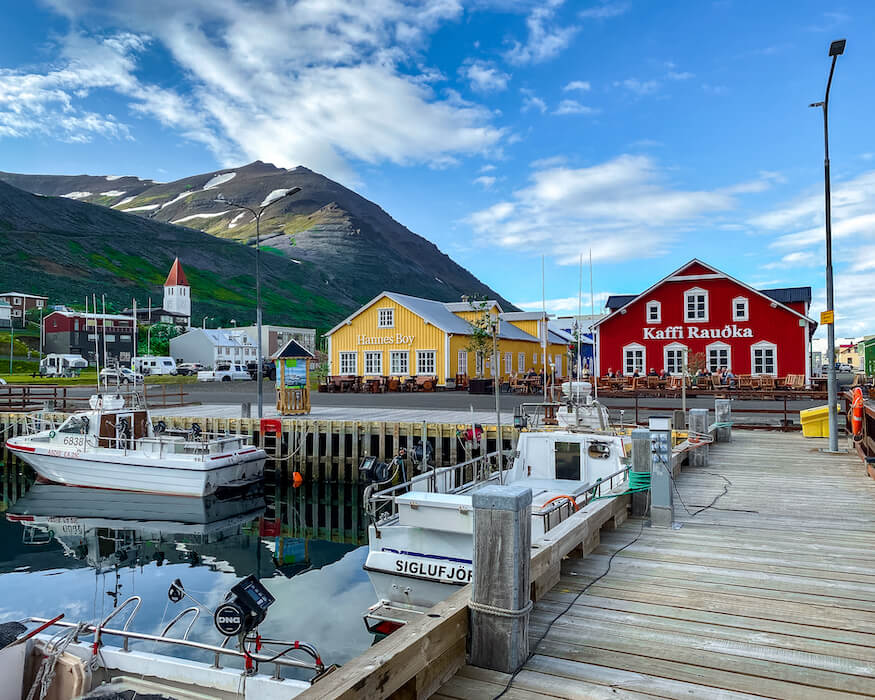 the harbor of Siglufjördur in iceland with colorful houses