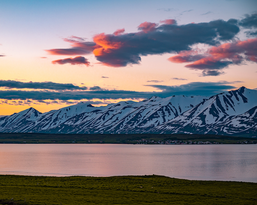 sunset behind snowy mountains iceland