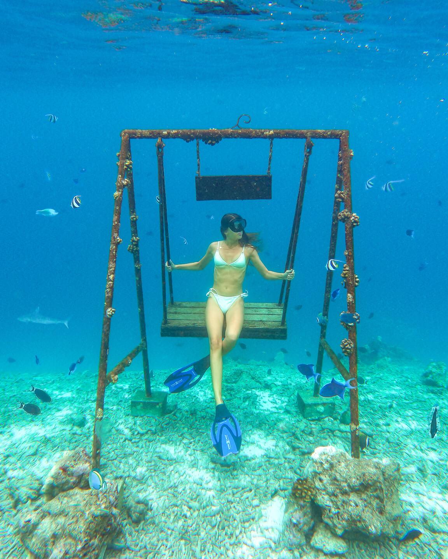 underwater swing Maldives