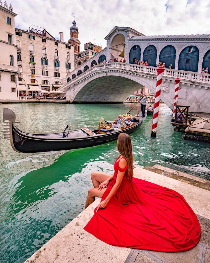 venice Rialto bridge girl in red dress