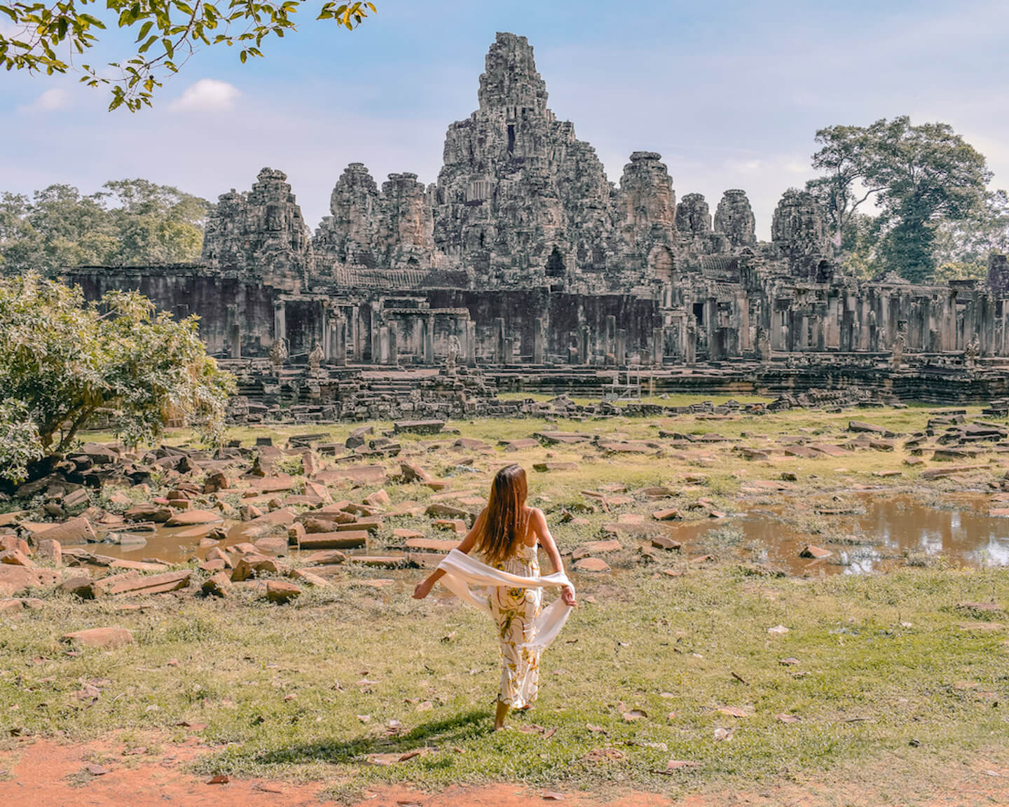girl in front of Bayon temple ruins in Angkor