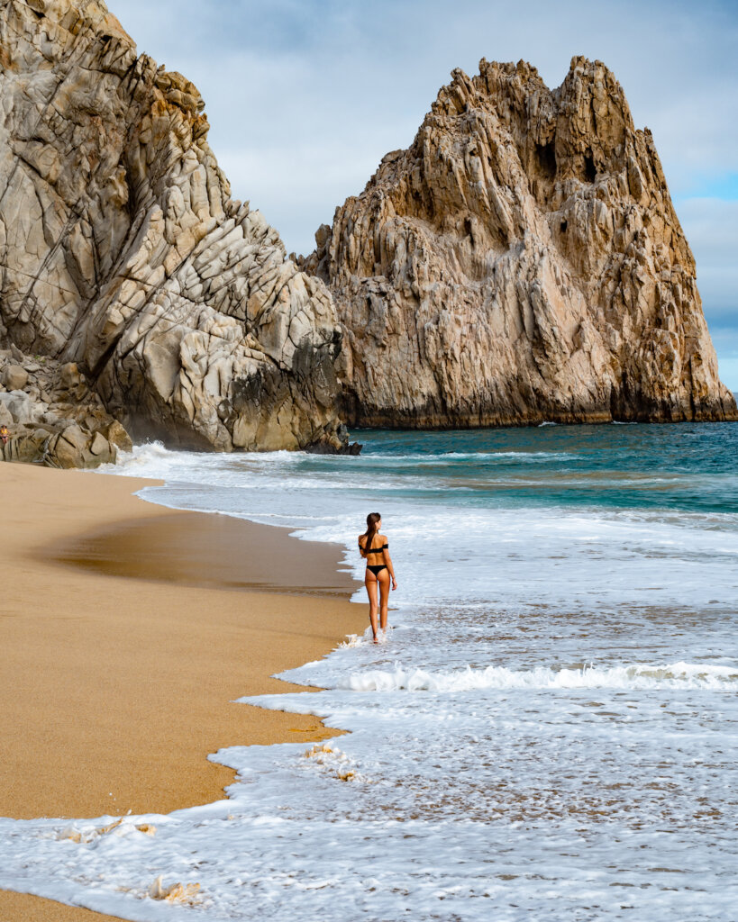 walking at the divorce beach in Cabo San Lucas Mexico