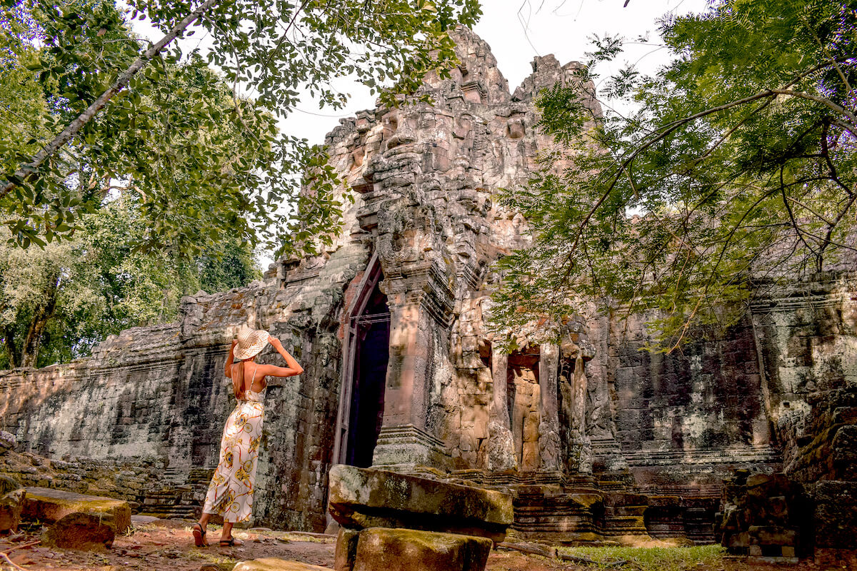 girl standing in fron of old ruin in Angkor Wat Cambodia