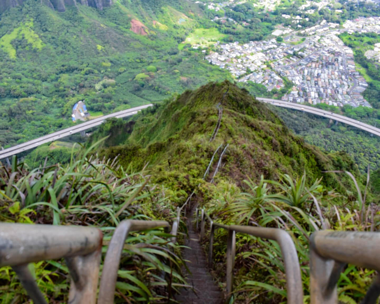 metal stairs leading down green hill in Oahu Hawaii