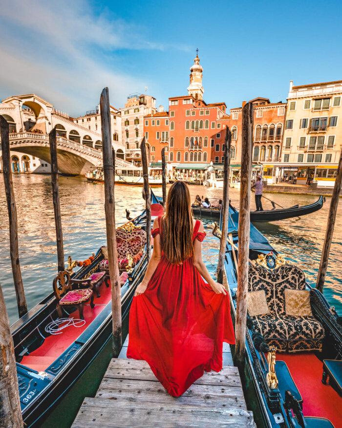 girl in red dress at canal grande in venice