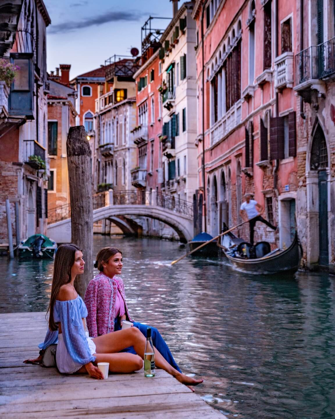 beautiful photo spot in venice, girls sitting at the canal