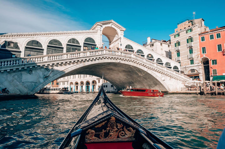 gondola ride under Rialto Bridge in venice