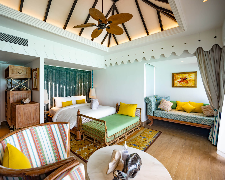 Bedroom of a water villa at the SAii Lagoon Maldives Hotel