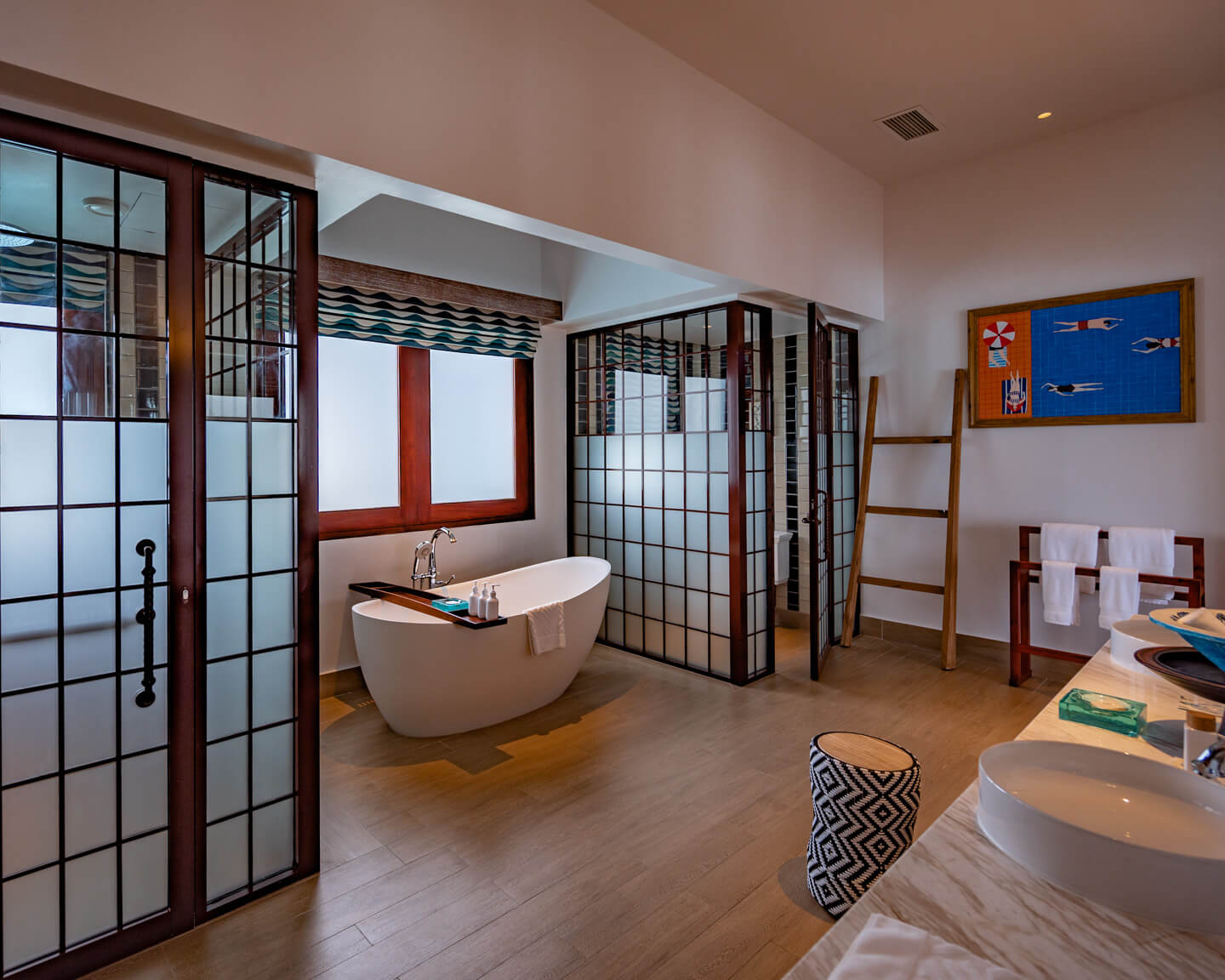 huge bathroom with bathtub and two sinks of the 2-bedroom overwater villa of the SAii Lagoon Maldives hotel