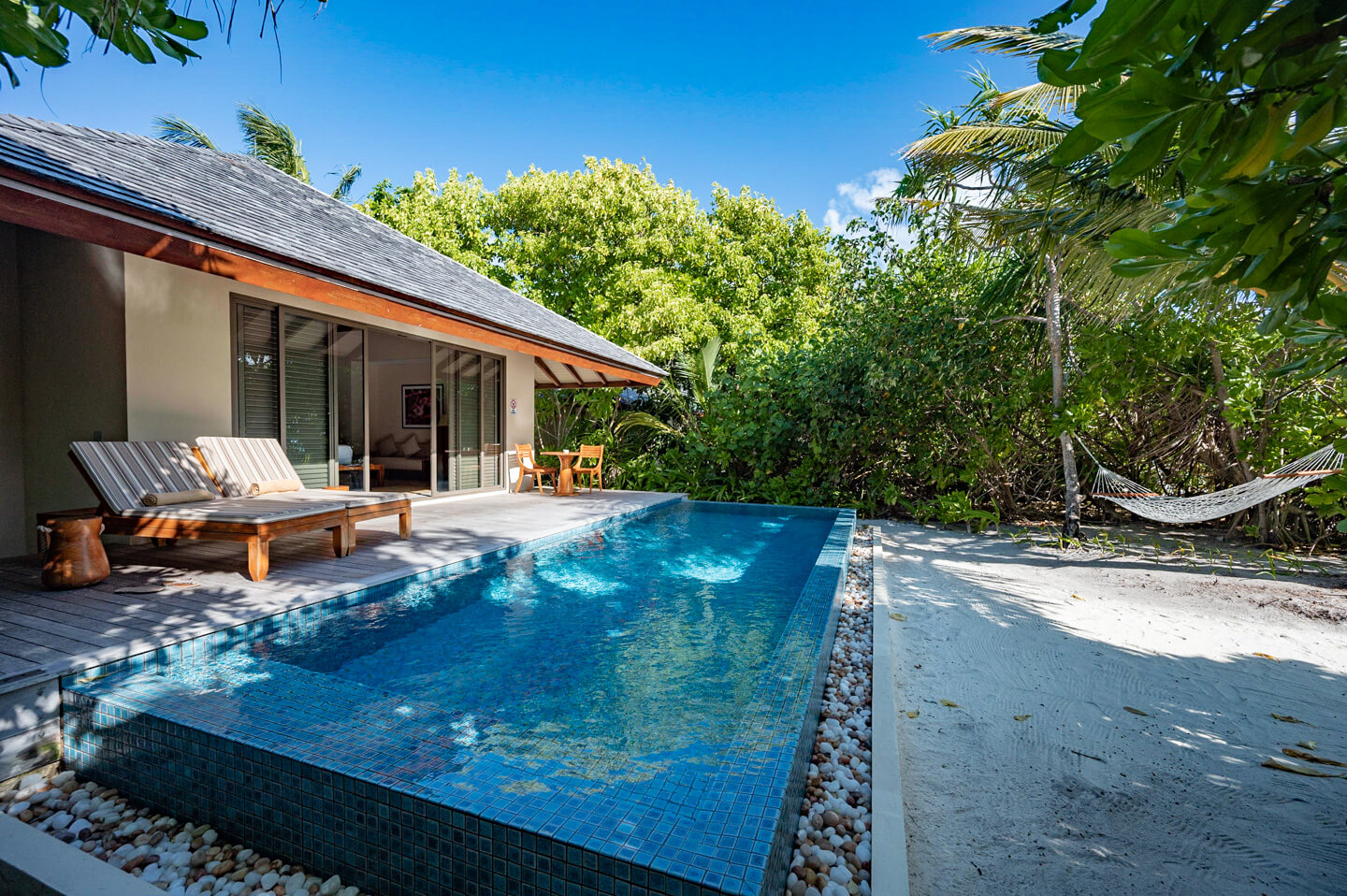 Sunset beach villa with pool and ocean access at the residence maldives dhigurah