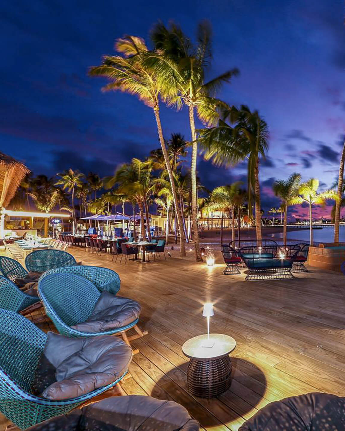 the elephant and butterfly restaurant at the har rock hotel maldives at night surrounded by palm trees