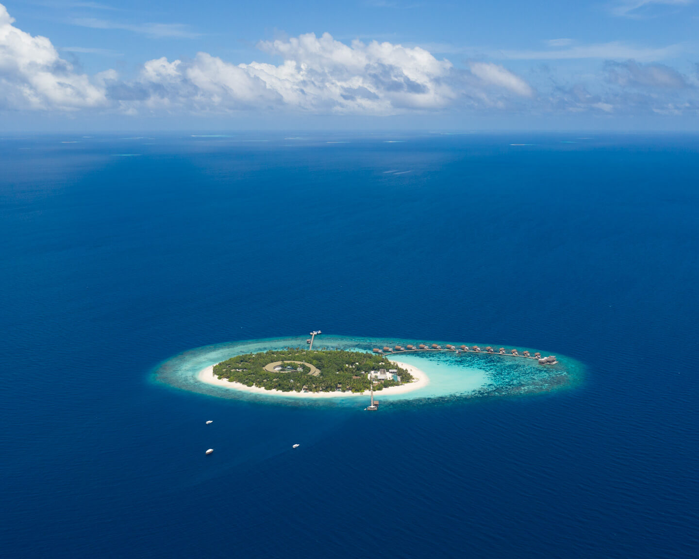 drone shot of the whole island Park Hyatt Maldives Hadahaa surrounded by blue water