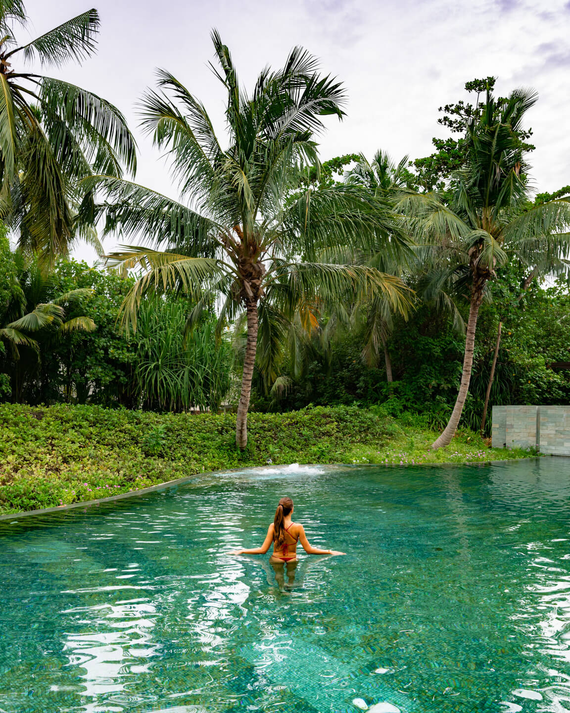 girl in a tropical pool in the maldives