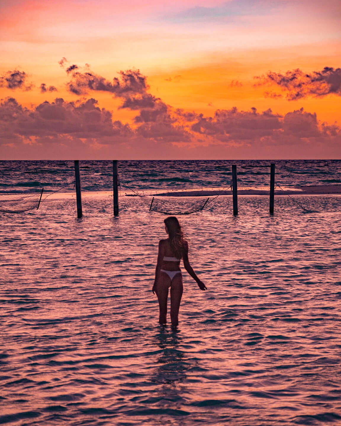 sunset at the sandnak in the ocean in the maldives