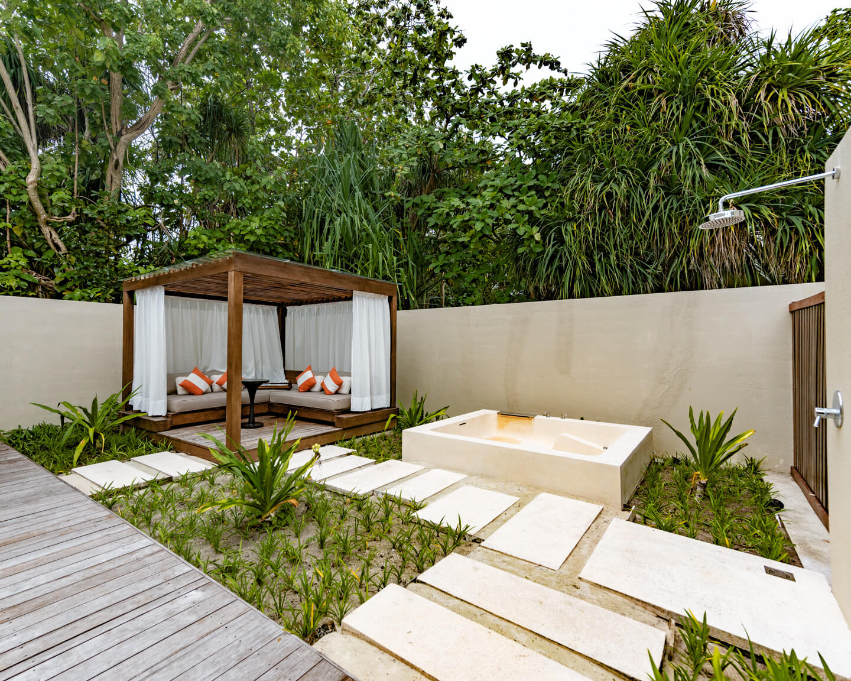 spa area outdoor area with bathtub at the Park Hyatt Maldives Hadahaa