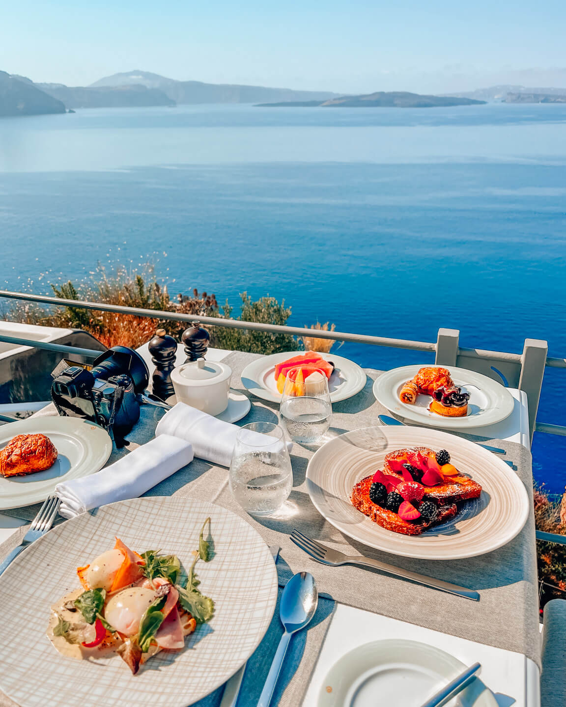 breakfast table with view over the sea in santorini, greece